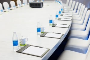 white table set for meeting